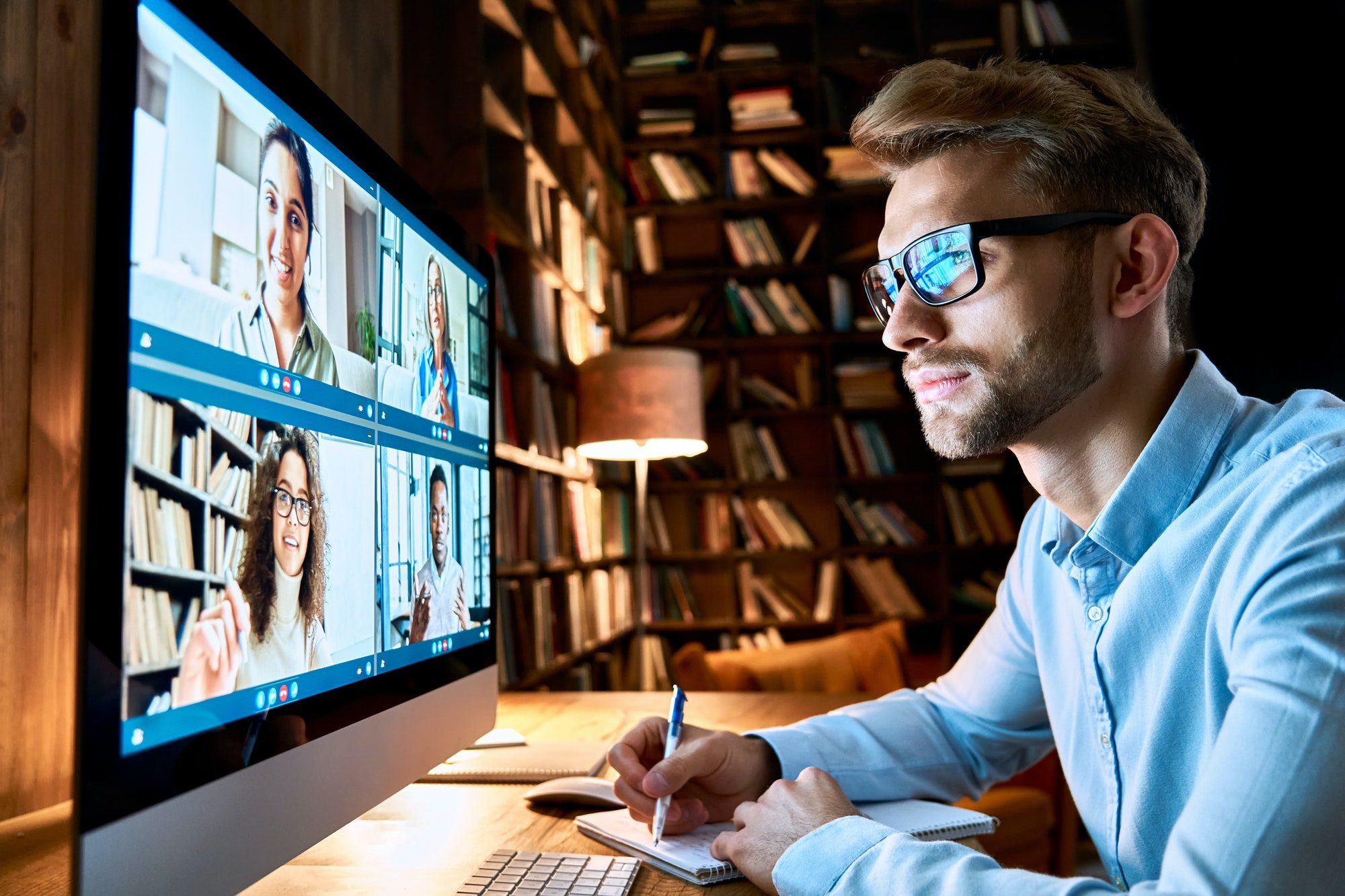 Businessman Having Virtual Team Meeting Chat On Video Conference Call Using Pc.