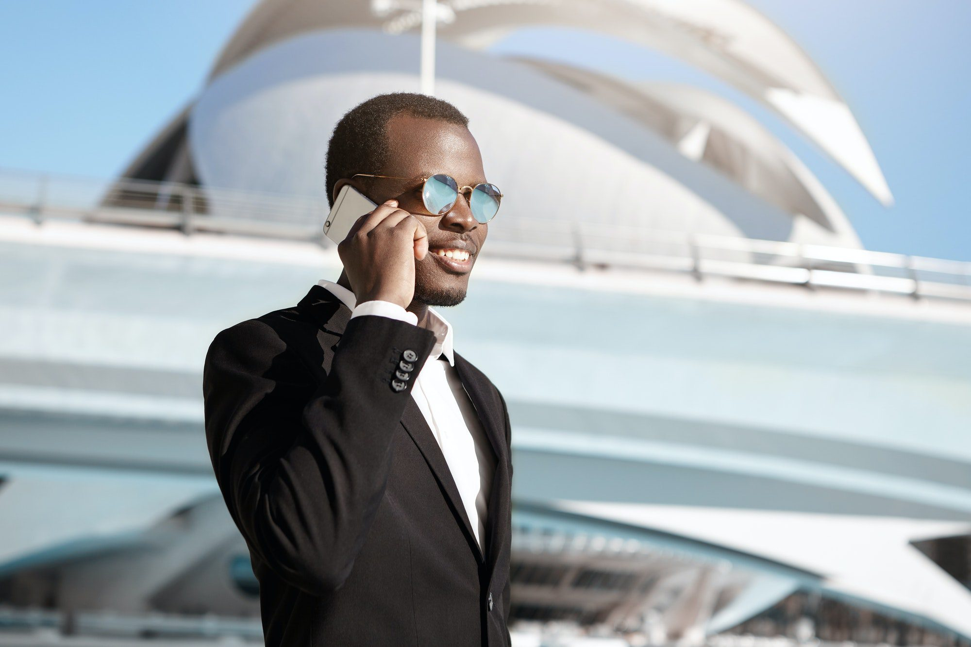 Businesspeople, Urban Lifestyle, Modern Technologies And Communication Concept. Joyful African CEO I